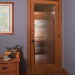 Glass Doors - Golden Oak door with Reed glass by HomeStory Doors