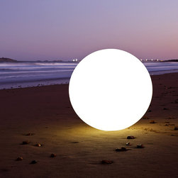 Ball - Outdoor Portable LED Lamp | Smart & Green - Floating delicately on your pool or elegantly placed on land, Ball diffuses a pleasant light to suit your requirements. White light, candle effect or 160,000 colors to choose from… there are so many options for your evening.  Because it can be immersed in up to 2 meters of water and is impact-resistant, this lamp offers many opportunities for fun and is recharged by simply placing it on its charging station.  And if you'd like to change the color or switch it off without getting up from your sofa, use Pebble, the compatible remote control unit that you'll find in the accessories section.