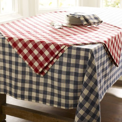 Gingham Check Tablecloth - You've got to have gingham at a picnic, right? There's nothing more classic than a red and white checked tablecloth. Grab some extras to lay on the grass for additional casual eating spaces.