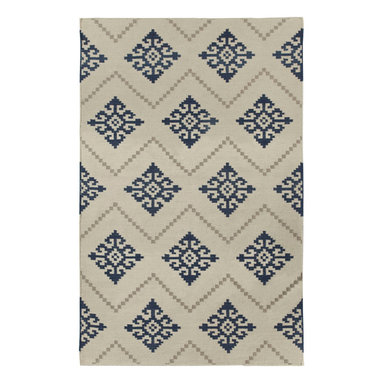 """Sno rug in Bokrum Blue - """"I was inspired to create a pattern that resembled the needlework that I had seen in Norway. The geometric patterns were almost tribal and so familiar, though some are over 1000 years old. Sno is a Scandinavian homage to the Mandala."""" - Genevieve Gorder"""