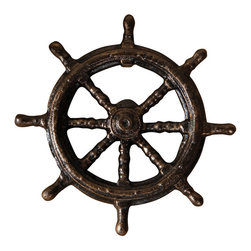 Ships Wheel Bottle Opener - Bronze - The detailed casting of the Ship's Wheel Bottle Opener makes this small barware element both decorative and useful. One spoke missing from the wheel offers both a rakish look and space to insert a bottle neck. In dark iron with a weathered black and bronze patina, the wheel is perfect for nautical decor and has a rich, handsome metallic color to give a traditional flair to your space.