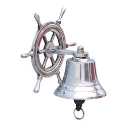 """Handcrafted Model Ships - Ship Wheel Chrome Bell 7"""" - Chrome Hanging Bell - Elegantly designed and gleaming with a lustrous shine, this fabulous Chrome Hanging Ship Wheel Bell 7"""" is equally stunning indoors or out. In addition to being fully functional, this ships bell is a great addition to any nautical decor themed room. Make a nautical wall decor statement and enjoy this wonderfully decorative style and distinct, warm """"strike through"""" nautical tone with each and every resounding ring."""