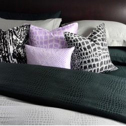 """Plush Living - Caiman Sheet Set in Jet Set Black - Canadian husband and wife team Kenneth and Shirley Wong met while in high school in Montreal. In 1994, they were best friends and light heartedly agreed to start a business together in the future. The idea came true 10 years later. In 2004, computer graphics and textile designer Kenneth joined forces with his now wife Shirley, a financial consultant for companies such as Molson's Brewery and Arthur Anderson, to createwhat is Plush Living today. Shirley and Kenneth now reside in Los Angeles with their 2 year old son. The Caiman collection is constructed from 400 thread count cotton sateen. The Caiman duvet and sheet set's jaquard pattern are inspired by the skin pattern of the Black Caiman Aligator of the Amazon. Designed by: Kenneth and Shirley Wong, 2004 Features: -Includes fitted sheet, flat sheet and 2 shams. -Caiman collection. -400 thread count. -100% Cotton Sateen. -Machine washable. -Available in king and queen sizes. Specifications: -Queen sham dimensions: 30"""" W x 20"""" D . -Queen fitted dimensions: 60"""" W x 80"""" D + 15"""" pocket. -Queen flat dimensions: 106"""" W x 96"""" D. -King sham dimensions: 20"""" W x 40"""" D . -King fitted dimensions: 78"""" W x 80"""" D + 15"""" pocket. -King flat dimensions: 114"""" W x 106"""" D."""