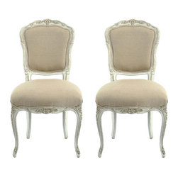 Provence Antiqued French Side Chairs - This is an amazing find! I love the details on the chairs' wooden frames. I'd probably change the fabric to something darker, such as a soft gray.