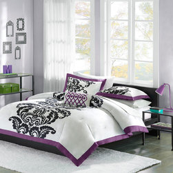 Mizone - Mizone Florentine Comforter Set - Florentine is a beautiful bed set mixing white, purple, and black in a striking way. The background of the comforter is a bright white with a large black damask motif running up the center, paired with a purple flange around all edges. The reverse is a solid purple that gives this set a pop of fun without looking too young. This bed set would work perfectly for any young girl looking for a more grown up look to her room. Comforter/sham face: 100% cotton print fabric; back: 100% polyester brushed fabric; filling: 200g poly fill; pillow: poly cover and poly fill.