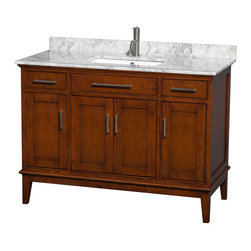 Wyndham Collection - 48 in. Eco-Friendly Transitional Bathroom Vanity - Includes white Carrera marble countertop with backsplash and undermount square sink. Faucet not included. Two functional drawers. Four functional doors. Pre-drilled for single hole faucet. 12 stage wood preparation, sanding, painting and hand-finishing process. Highly water-resistant low V.O.C. sealed finish. Practical floor-standing design. Deep doweled drawers. Fully-extending under-mount soft-close drawer slides. Concealed soft-close door hinges. Single faucet hole mount. Plenty of storage and counter space. Metal exterior hardware with brushed chrome finish. Engineered to prevent warping and last a lifetime. Made from zero emissions solid birch hardwood. Light chestnut finish. Vanity: 47 in. W x 21.5 in. D x 34.25 in. H. Vanity with Countertop: 48 in. W x 22 in. D x 35 in. H. Countertop: 48 in. W x 22 in. D x 0.75 in. H. Backsplash: 48 in. W x 0.75 in. D x 3 in. H. Warranty. Care Instructions. Counter Handling Instructions. Installation InstructionsBring a feeling of texture and depth to your bath with the gorgeous Hatton vanity series. A contemporary classic for the most discerning of customers. The Wyndham Collection is an entirely unique and innovative bath line. Sure to inspire imitators, the original Wyndham Collection sets new standards for design and construction.