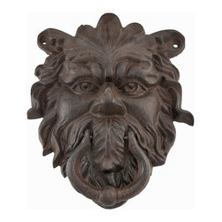 Cast Iron Greenman Door Knocker Rust Colored Patina - Add a decorative accent to your door with this Greenman door knocker. Made of cast iron, it measures 9 inches tall, 7 inches wide, 2 inches deep, and has a beautiful rust colored patina. This piece has 3 pre-drilled holes for mounting it to the door. It makes a lovely housewarming gift for followers of Nature religions, and is sure to be admired.