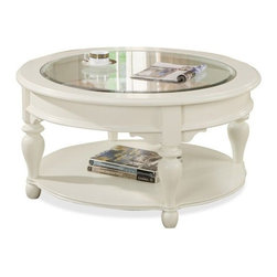 Riverside Furniture - Essex Point Round Cocktail Table - One fixed bottom shelf.