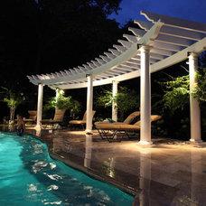 Mediterranean Patio by SPLASH pool design by Brian T. Stratton