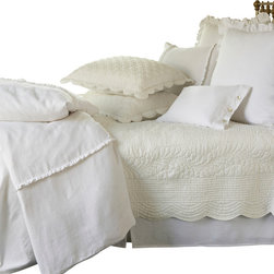 "Taylor Linens - Beth King Quilt - The Beth Quilt is a soft cream color and has been delicately hand-stitched with gentle scallops and cording detail. It is made from 100% cotton fabric and is machine washable. This quilt comes in a soft cream color. 110""x100"""