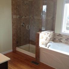 Modern Showerheads And Body Sprays by Cincinnati Glass Contractors llc