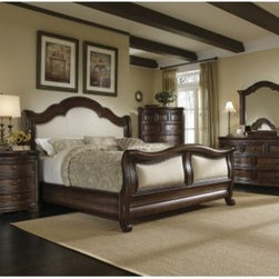 A.R.T. Furniture Coronado Upholstered Sleigh Bed - Barcelona - You'll surely say ole to the gorgeous elegance of the Spanish-inspired A.R.T. Furniture Coronado Upholstered Sleigh Bed - Barcelona. A rich Barcelona finish highlights the curves, carvings, and details of the beautifully-crafted head- and footboard. Soft, neutral upholstery adds contrast to this beauty, while nail head trim provides the kind of details that make this an heirloom piece.Queen: 98.5L x 67W x 68H inchesKing: 98.5L x 83W x 68H inchesCalifornia king: 102.5L x 83W x 68H inchesAbout A.R.T. FurnitureA.R.T. Furniture is quality furniture inspired by architecture and design. A.R.T. Furniture pieces are top-quality and are loaded with practical and luxurious features. Extra steps are taken to ensure quality, beauty, and durability. English dovetailing, dust-proofing on all cases with wood guides, and wood-on-wood drawer guides show fine craftsmanship. A UV finishing process on the drawer interiors provides a smooth, durable finish and snag-free storage. All bottom drawers of bedroom storage pieces are lined with aromatic red cedar. Jewelry trays in bedroom pieces and silverware liners in dining pieces keep items protected. Any media pieces feature sophisticated wire management and ventilation solutions.