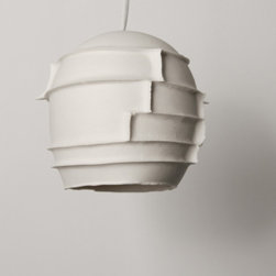 """Lightexture - Spikes - Designed and made in the USA by Yael Erel, Avner Ben Natan, and Sharan Elran.   This Spiky shaped pendant light is made of white translucent porcelain that shines in an amber tone. The light comes with a braided cord and a matching clay ceiling plate. Spikes is the outcome of exploring seam lines in porcelain casting.Usually seams are considered a problem, something to erase and cover but in translucent porcelain you just can't do it.   The light going through will reveal any seam like an X ray. This lamp then is celebrating these fault lines in a decorative way. The mold was broken into many pieces producing many seam lines and evidence of the casting process which create different thicknesses of porcelain transmitting different intensity of light. This pendant light is supplied with a 35W xenon bulb that is twice more efficient in its energy use than a regular incandescent (equivalent to 70W incandescent), has a longer life span of 5,000 hours and a warm color light quality.   Supplied with 35W xenon bulb that is twice more efficient in its energy use than a regular incandescent (equivalent to 60-75W incandescent), has a longer life span of 5,000 hours and a warm color light quality. All electrical parts are UL listed. dust with clean dry cloth 35W xenonSpecification:  Color : white  Finish : Matte  Weight (lbs.) : 2  Bulb Type : 35W xenon  Country of Origin : USA  Material : Porcelain, Clay  Care : dust with clean dry cloth  Max wattage : 50W xenon / Halogen  Fulfillment Type : Ship directly to customers  Cord Length : up to 36"""" - can be shortened on installation      Dimension    Length  Width  Height    5""""  5""""  5.5"""""""