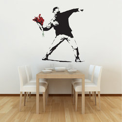 Small Flower Thrower Wall Sticker - Make love not war! The Banksy Flower Thrower Wall Sticker is inspired by the infamous UK graffiti artist Banksy. It features a rioter poised as if to throw a grenade or a brick, but the weapon has been replaced with a bright red bunch of flowers. Based on Banksy's anti-violence message, this wall sticker makes a bold statement and is the perfect way to express your own political views in your home. This beautifully designed wall decal is precision cut from high grade, low-tac self-adhesive. It's easy to apply, completely removable, and comes with detailed instructions for application. Perfect for adding a modern touch to your home, office, or dorm room!
