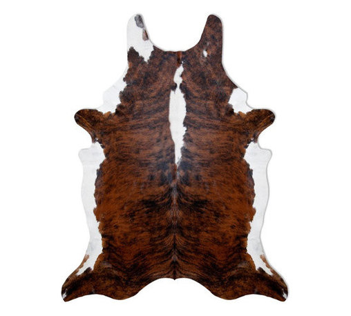 Pure Rugs - Natural Cowhide Classic Brindle Rug - Since the 1800's the Brindle Cowhide Rug has been a classic decor element used on the charming estancias of Buenos Aires. Originating from the Pampas Grasslands of Brazil, our hides are individually selected for their superior quality, shine and softness. These premium cowhides are hand finished for the perfect look. Naturally stain resistant, these rugs are very durable and easy to maintain. Features: -Material: 100% Natural Cowhides, never dyed.-Origin: Brazil.-100% Biodegradable and natural.-Backing is the natural suede of the hide with weighted suede corners so the ends don't peel up.-Durable and easy to maintain.-Shaken out and vacuumed on a low setting.-Non-shed and are stain repellent by quality of pure hides.-Exposure to direct sunlight will change the material characteristics and color.-Collection: Natural Cowhide.-Distressed: No.-Collection: Natural Cowhide.-Primary Color: Brown and Black.-Material: Cowhide.-Fringe: No.-Reversible: No.-Rug Pad Needed: No.-Water Repellent: No.-Mildew Resistant: No.-Stain Resistant: Yes.-Fade Resistant: Yes.-Swatch Available: Yes.-Outdoor Use: No.-Product Care: Lightly vacuum. Use moist cloth for immediate stain..Specifications: -CRI certified: No.-Goodweave certified: No.Dimensions: -Pile Height: 0.25.