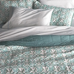 Ikat Aqua King Quilt - Gorgeous tones of blue and green overlap in a modern ikat pattern on soft, 100% cotton. Lightweight yet cozy quilt is hand quilted and reverses to solid aqua. -Hand-quilted