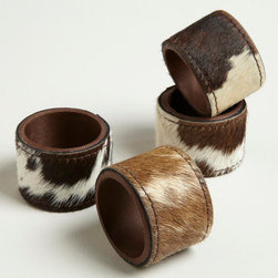 Cowhide Napkin Rings - These cowhide napkin rings pack a style punch, but they don't take things too seriously. I would use these to add some playfulness and fashionable fun to an elegant tablescape.