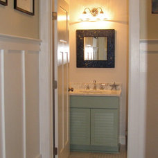 Beach Style Powder Room by Debcan Construction