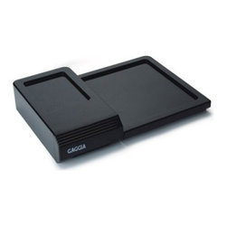 Gaggia 9001 Base - The Gaggia 9001 Base provides a sturdy, centralized spot to keep your espresso machine and equipment organized. Available in black, this base is made of durable plastic and is suitable for Gaggia semi-automatic machines and grinders. It features an accessory drawer to hold filter baskets, scoops, and other items. The pull-out drawer also provides you with a knock box for your coffee grounds.About GaggiaGaggia is the number-one selling home espresso machine manufacturer in Italy. Achille Gaggia, known as the founder of the modern espresso machine, founded the company in 1947. His innovative design eliminated steam from the extraction process and gave us the thick, crema-topped espresso that's so popular today. In 1977, the Gaggia company began producing machines for home use, and since that time, they have been at the forefront of development and innovation in the industry. Gaggia espresso machines combine Old World, classic styling with cutting-edge technology to bring you feature-packed machines that are easy to use and look fantastic in your kitchen. Enjoy espresso in the true Italian style with Gaggia.