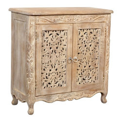 None - Carver 2-door Cabinet - This beautifully crafted collection showcases simple lines paired with striking features. The intricate hand-carving of floral patterns in this solid Acacia wood create a collection that effortlessly blends with traditional or transitional decor.