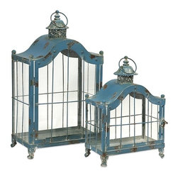 "IMAX CORPORATION - Jordan Lanterns - Set of 2 - With antiqued blue finish, our Jordan Lanterns are expertly crafted from iron and exude a classic charm. Add the ambiance of candlelight with these handsome accents.  Set of 2 lanterns measuring 40""H x 33""W x 22""L and 55""H x 28""W x 16""L each. Find home furnishings, decor, and accessories from Posh Urban Furnishings. Beautiful, stylish furniture and decor that will brighten your home instantly. Shop modern, traditional, vintage, and world designs."