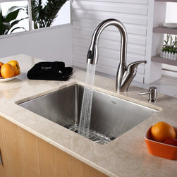 Kraus - Kraus KHU101-23-KPF2121-SD20 Single Basin Undermount Kitchen Sink with Faucet Mu - Shop for Kitchen from Hayneedle.com! Bring your kitchen set up to date with the Kraus KHU101-23-KPF2121-SD20 Single Basin Undermount Kitchen Sink with Faucet and its innovative design and style. Transforming into a powerful sprayer with the push of a button the arching spout operates smoothly with a single handle. An oversized basin offers plenty of space for any task at hand.Product SpecificationsBowl Depth (inches): 10Weight (pounds): 27Low Lead Compliant: YesEco Friendly: YesMade in the USA: YesHandle Style: LeverValve Type: Ceramic DiscFlow Rate (GPM): 2.2Spout Height (inches): 6.5Spout Reach (inches): 8About KrausWhen you shop Kraus you'll find a unique selection of designer pieces including vessel sinks and faucet combinations. Kraus incorporates its distinguished style with superior functionality and affordability while maintaining highest standards of quality in its vast product line. The designers at Kraus are continuously researching and exploring broader markets seeking new trends and styles. Additionally durability and reliability are vital components at Kraus for developing high-quality fixtures. Every model undergoes rigorous testing and inspection prior to distribution with customer satisfaction in mind. Step into the Kraus world of plumbing perfection. With supreme quality and unique designs you will reinvent how you see your bathroom decor. Let your imagination become reality!