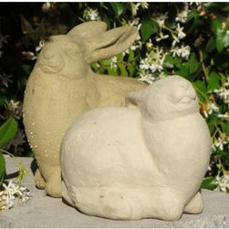 Jessica Rabbit Garden Statue - We doubt that she'll attract Roger into your garden, but the Jessica Rabbit Garden Statue creates a lovely impression. This statue captures a plump, peaceful rabbit sniffing the air. The rabbit's sensitivity and intelligence are conveyed in the detailed attention paid to the rabbit's expression. Crafted in the USA, and finished with a waterproof sealant.About Designer StoneSince 1999, the family-owned Designer Stone has been proudly manufacturing American made garden variety stoneware in a creative range of prices and functions for every standard of living. With artist designed sculptures and planters, Designer Stone's aim to create spiritually moving and enlivening pieces intends to evoke the precious moments from a garden that remind us who we are and what we do. With every purchase backed by a no-hassle guarantee, Designer Stone promises high-quality products that will enhance your home or garden, no ifs ands or buts.
