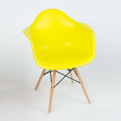 "Montmartre Arm Chair in Pop Yellow - Some designs were ahead of their time. Considered the chair of tomorrow both for its design and its innovative single-mold manufacturing process, the Montmarte Arm Chair is inspired by one of the most iconic mid-century furniture designs. Created in the spirit of economy and affordability, its unique shape was designed to spread the sitter's weight and pressure evenly. The deep seat and waterfall edge provide additional comfort as the design shapes itself around the body's curves, while its ashwood dowel legs add a classic touch. If you've done away with formality in your home, the Montmarte Arm Chair is that one piece of furniture that exemplifies the ""less is more"" ethos. It's the ultimate seat that goes well in a variety of different settings: as a home office chair, an entryway slipper seat, or a statement piece in the living room."