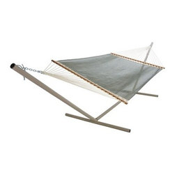 Pawleys Island Autumn Fern Textilene Large Poolside Fabric Hammock - Say goodbye to hard plastic pool chairs and hello to the Pawleys Island Autumn Fern Textilene Large Poolside Fabric Hammock. The tightly woven Textilene fabric dries super fast so you can relax in perfect comfort after a dip in the water. Solid oak spreader bars have a beautiful finish that ensures durability and worry-free care. Mildew and fade resistant this hammock will stay beautiful and vibrant for years to come. Featuring plenty of room for two it won't be hard to find someone to share in the comfort with you. In fact you may have to hand out numbers - this is sure to become the most in demand seat by the pool. About Pawleys IslandIn 1889 the Original Pawleys Island Rope Hammock was created at Pawleys Island one of the oldest summer resorts on the South Carolina coast. When river boat pilot Captain Joshua John Ward found the grass-filled mattresses on his boat too hot in the summer he decided to make a cool and comfortable cotton rope hammock to use on his boat. After several uncomfortable designs Cap'n Josh made a hammock using wooden spreaders without knots. This original design has proven to be so comfortable that it's still used in Pawleys Island's popular hammocks over a century later. Pawleys Island continues to use the highest quality materials when making their traditional all-cotton rope spun polyester rope and DuraCord hammocks. Their custom-designed stretcher bars are cut from seasoned Carolina red oak then steamed bent drilled sanded and varnished to impart a comfortable sway to the hammock and to spread the rope evenly for optimum stability. The people of The Original Pawleys Island Rope Hammock are incredibly proud to be anything but new-fangled. Now 120 years old and counting they continue to offer the very best of their past hoping it will help you better enjoy your future.