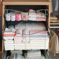 Pull-out basket - Slide-out wire baskets make it easy to grab frequently used items.