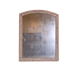 Arched Mirror with Rosettes - Suggest a timeless heirloom when you shed reflected light on your decor with this simple and graceful mirror. One of our best-sellers, it consists of nine individual mirror panels secured with four small craftsman rosettes at the corners, each hand-finished with a pale, rustic weathered wood tone to match the slim arched and molded outer frame. The artisan mirror's shape is simple, its inspirations are architectural, and its effect is astounding.
