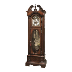 "Howard Miller - Howard Miller Coolidge Floor Clock In Hampton Cherry Finish - Howard Miller - Floor Clocks - 611180 - Hampton Cherry finish with distressing on select hardwoods and veneers. A graceful stepped swan neck pediment features a book-matched olive ash burl overlay panel with a turned finial rosettes and a decorative shell ornament. The polished brass finished dial features cast corner and center ornaments and a moon arch with an astrological blue moon phase. The dial includes a silver chapter ring with applied polished brass Arabic numerals. The dial is specially inscribed with ""Presidential Collection"" in the hemispheres of the moon phase. The dial is complemented by the polished brass finished weight shells with decorative bands and the pendulum with a cast center disk. Beveled glass throughout. The lower front door features an oval patterned beveled glass framed with book-matched olive ash burl overlays."
