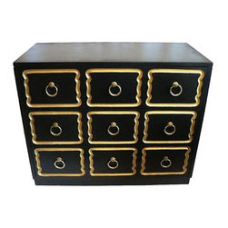 Pre-owned Dorothy Draper Style Chest Of Drawers - A Hollywood Regency, Dorothy Draper style chest of drawers with beautiful gold accents on each of the three drawers and a glossy black finish. The original brass knobs have a patina, but can be shined if desired. There is no maker's mark visible.