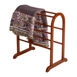 Winsome Trading - Dylan Quilt Rack - 94326 - Shop for Caddies and Stands from Hayneedle.com! What We Like About the Dylan Quilt RackThe Dylan Quilt Rack employs simple elegant curves to stand the test of time. This quilt rack will continue to display your heirloom quilts and blankets with a dignified touch for years to come. The flat base legs stand low to the ground for ample stability and are slightly arched for classic good looks. Dramatic and appealing arches grace the top of this quilt rack. Six display rods offer many options for the linens blankets and quilts you want to display. This quilt rack is available in a handsome walnut finish. For attractive display of your treasured spreads and handiwork look no further than the Dylan Quilt Rack.