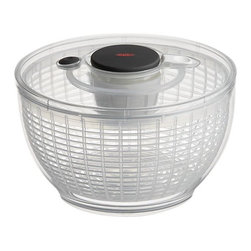 OXO® Mini Salad Spinner - Now available in mini size, this see-through plastic spinner whisks water off greens, herbs and berries with a quick press of the pump. Press the brake to stop motion. Nonslip ring grips countertops; knob locks down for storage convenience.