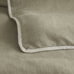 Mandalay Khaki Bedding Collection - Mandalay Khaki. We search the world for interesting, unusual products of the highest quality and best value. This time we found someone in our own backyard (or alley as it were) that has done the work for us. We are proud to partner with our friends and Dallas neighbors at Peacock Alley to bring you a selection of high quality linens specifically chosen to create a look exclusive to Wisteria.