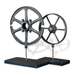 Kathy Kuo Home - Perriand Industrial Loft Style Wheel Antique Iron Sculptures - Set of 2 - Two antique-finished iron wheel sculptures rest atop black marble pedestals, blending industrial with modern. Hollow, textured metallic circles oppose solid, polished black marble blocks, attracting all the right attention.