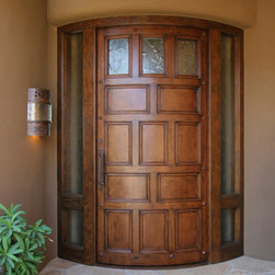 Entry Door - Curved Alder Hardwood Frame and Panel Entry Door with Antiqued Finish.  Photo by Doug Forsha