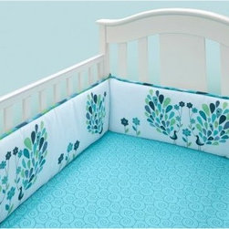 Bananafish Peacock Blues Crib Bumper - Grace your little one's crib with the safe and protective Bananafish Peacock Blues Crib Bumper. Made with soft, cozy cotton, the cushioned bumper set includes two short and two long sides. It has an easy tie assembly and fits most crib rail formats. It features a sophisticated peacock design in beautiful shades of blue and green. Machine wash these bumpers on cold.Dimensions: Short: 10W x 27.5L in.Long: 10W x 51.5L in.About BananafishBananafish was founded in 1997 and has grown to become a leading manufacturer of infant bedding and nursery décor. In 2007 Bananafish became part of the Betesh Group family. Bananafish has found success tapping into global design resources to bring the latest trends to their product lines. While on-trend, they still manage to balance a look that appeals to classic and contemporary tastes. You'll find Bananafish products featured in all the hot media, such as Pregnancy Magazine, American Baby, HGTV.com, OK Pregnancy and Newborn, and more. Luxurious comfort, superior quality, and style that lasts, Bananafish will help you create a nursery that delights.
