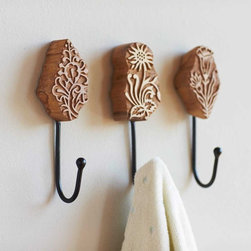 """Viva Terra - Block Print Hooks (set of 3) - Artists specializing in block-print textiles first carve intricate motifs into wood blocks such as these to create their beautifully patterned textiles. We found the wooden blocks themselves so captivating we fashioned them to serve as handy yet artful hooks for towels or coats. 2.25""""W x 1.5""""D x 8""""H"""