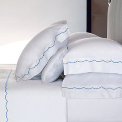 """Frontgate - Yves Delorme Douce Euro Sham - Yves Delorme has been a family-owned purveyor of fine linens since 1845. Made in France of Egyptian cotton, sateen woven for luxurious softness. 300 thread count. Simple design pairs well with other bedding items. Knife-edge duvet cover has button closure. Our Yves Delorme Douce Euro Sham brings a charming, delicate approach to the all-white, hotel-style embroidered bedding ensemble. Rather than a straight-lined trim, a scalloped detail accents the outer hem of the shams.. . . . . Pair with the Yves Delorme solid-white sateen 18"""" deep fitted sheet with elastic on all sides. Machine wash and tumble dry low; see product label for further instructions."""