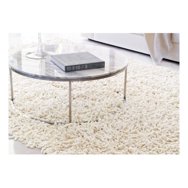 Design Within Reach - Nesta Rug   Design Within Reach - Even though you may have to roll it up and take it back in the house with you at the end of your date night, why not roll out a shag throw rug to sink your toes in?!