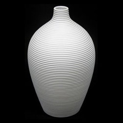 Urban Trends Rounded Ceramic Vase White - 13H in. - About Urban Trends Collection:Urban Trends Collection is a leading home décor and decorative home accessories company. They specialize in the latest home furnishings, decorative home accessories, accent pieces, and garden accessories. Urban Trends is a global company that provides quality, reasonably priced home decor to their customers. They deal extensively in decorative home accessories items crafted in Spain, China, India, Turkey, and the Philippines. Urban Trends works with the best artisans and craftspeople as well as only quality manufacturers and reputable factories.