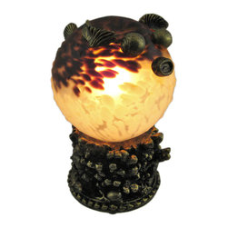 Zeckos - Stained Glass Blowfish Table Accent Lamp Blow Fish - This beautiful marbled brown and white stained glass blowfish shaped lamp adds the perfect accent to desks or nightstands of blowfish lovers. Measuring 8 inches tall, 5 inches wide and 7 inches deep, the lamp features an antiqued bronze finished resin base of coral, with the body of the blowfish made of mottled white and brown stained glass. The lamp is brand new, never used or displayed. It uses one nightlight style bulb (included). It makes a great gift idea. We have a very limited supply of these, so don't delay. Get yours now