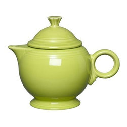 Fiesta Lemongrass Covered Teapot - 44 oz. - About FiestaAmerica's favorite dinnerware line, Fiesta was introduced by the Homer Laughlin China Company in 1936. Available in plenty of bright, vibrant colors and unique shapes, Fiesta dinnerware and serveware features Art Deco-style concentric rings. Made from durable, restaurant-quality ceramic and finished in lead- and cadmium-free glazes, this line of kitchenware is easy to mix and match to create your own custom set. Best of all, each piece is microwave- and oven-safe, and dishwasher-safe for easy cleanup.