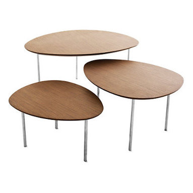 Eclipse Nesting Tables, Set of 3 - Jon Gasca was inspired by nature when he designed the Eclipse Nesting Tables (2009) – but quality, affordability and versatility followed suit. Each Table in this set of three is a different shape and different height, allowing for endless configurations. The smaller tables can be concealed under the largest and brought out and arranged when more surface space is needed. A contemporary interpretation of traditional nesting tables, this set is suitable for either residential or contract use. Felt glides protect floors.