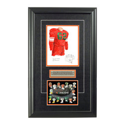 """Heritage Sports Art - Original art of the NCAA 1945 Miami Hurricanes uniform - This beautifully framed NCAA football piece features an original piece of watercolor artwork glass-framed in an attractive two inch wide black resin frame with a double mat. The outer dimensions of the framed piece are approximately 17"""" wide x 28"""" high, although the exact size will vary according to the size of the original piece of art. At the core of the framed piece is the actual piece of original artwork as painted by the artist on textured 100% rag, water-marked watercolor paper. In many cases the original artwork has handwritten notes in pencil from the artist. Simply put, this is beautiful, one-of-a-kind artwork. The outer mat is a rich textured black acid-free mat with a decorative inset white v-groove, while the inner mat is a complimentary colored acid-free mat reflecting one of the team's primary colors. The image of this framed piece shows the mat color that we use (Orange). Beneath the artwork is a silver plate with black text describing the original artwork. The text for this piece will read: This is an original, one-of-a-kind watercolor painting of the 1945 Miami Hurricanes uniform worn by #62 Bill Frantz and was used in the creation of this Miami Hurricanes uniform evolution print and thousands of Miami products that have been sold across North America. This original piece of art was painted by artist Nola McConnan for Maple Leaf Productions Ltd. Beneath the silver plate is a 6.5"""" x 7"""" reproduction of a uniform evolution print that celebrates the history of the team. The print beautifully illustrates the chronological evolution of the team's uniform and shows you how the original art was used in the creation of this print. If you look closely, you will see that the print features the actual artwork being offered for sale. The 6.5"""" x 7"""" print is shown above. The piece is framed with an extremely high quality framing glass. We have used this glass style for many years with e"""