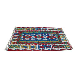 """Natural Handspun Wool Carpet - Turkish wool area rugs add warmth, color and culture to the home. Turkish kilim style carpet is made of 100% handspun wool dyed in rich, vibrant colors.  Handwoven in patterns unique to the tribes of the old Anatolian regions where various motifs and symbols woven into the carpet tell a weaver's story. Turkish wool rugs add a cozy, decorative touch in any room throughout the home. They also make nice rustic cabin or lodge accent rugs or used creatively as a carpet wall hanging. Flatweave wool area rug is approximately 41""""x 66""""; Made in Turkey."""