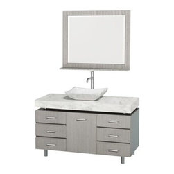 "Wyndham Collection(R) - Malibu 48"" Bathroom Vanity Set by Wyndham Collection - Gray Oak Finish with Whit - The Malibu 48"" Bathroom Vanity Set in Gray Oak finish with is one of the newest additions to the Wyndham Collection Designer Series by Christopher Grubb. It stands tall among contemporary bathroom vanities and demands the attention modern bathroom design evokes. This amazing vanity comes complete with ample storage space, statement making counter, and customizable handles. Its thick marble counter expand the glamour and modern design of this vanity, and will transform your bathroom into a contemporary masterpiece. Each counter is custom made with abundant marble facing in White Carrera or CaesarStone (also available in Ivory). This is a Wyndham Collection original design, and is therefore only available in very limited numbers. Incredibly, this price is for the vanity, sink, mirror and FREE SHIPPING! Counters are pre-drilled for a single-hole faucet. Please contact us for 3-hole faucets. Also available in multiple sizes and countertop options. The vanity is completely finished and without handles attached. This allows custom placement of all 7 handles or only as many as you desire, because each door and drawer can be opened without a handle. Features Constructed of beautiful natural wood veneers over solid oak hardwood Cutting edge, unique styling by Interior Designer Christopher Grubb 8-stage painting and finishing process Floor-standing vanity Fully-extending under-mount soft-close drawer slides Deep doweled drawers Soft-close concealed doors hinges Single-hole faucet mount Faucet not included Brushed Steel finish legs and counter supports Stunning custom-ordered natural marble ""floating"" 4"" deep counter Includes choice of porcelain or optional granite vessel sink Includes matching mirror 1 door, 6 drawers How to handle your counter Spec Sheet for vanity Installation Guide for Countertops with Vessel Sinks Installation Guide for Vessel Sinks Installation Guide for Mirrors Stone Vessel Sink Installation Guide "" target=""_blank"" class=""pdf""Installation Guide for Mirrors --> Spec Sheet for WC-V202 Spec Sheet for WC-V203 Spec Sheet for WC-V205 Spec Sheet for WC-V207 Installation Guide for WC-V207 Please note that all custom natural stone and Caesarstone counters are proudly manufactured in the USA specifically for your order, and so require up to 3 weeks manufacturing time. Caesarstone Carbone, Starry Night, Spring Blossom, and Marrone are made from recycled content. Quartz Reflections and Ruby Reflections colors are made with up to 35% post-consumer recycled glass. Chocolate Truffle color is made with up to 17% post-consumer recycled glass.Natural stone like marble and granite, while otherwise durable, are vulnerable to staining from hair dye, ink, tea, coffee, oily materials such as hand cream or milk, and can be etched by acidic substances such as alcohol and soft drinks. Please protect your countertop and/or sink by avoiding contact with these substances. For more information, please review our ""Marble & Granite Care"" guide."