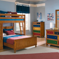 Riley Pine II Kids Bedroom Collection - Artist's Palette. With our Colorworks Pine II collection, your child can arrange the Artist's Palette. With our Riley II Pine collection, your child can arrange the hues in any combination for an inviting and creative bedroom that's a reflection of their personal style. Presented in a warm pine finish, this group features multi-colored, interchangeable drawer panels that add pops of bright color. The panels can be changed and rearranged easily and quickly, so your child's bedroom can go from subdued to brightly multi-colored with nearly endless variations in between. The space saving and practical loft bed features a Twin bed up top, a Full bed beneath and practical built-in bookshelves and cabinet storage.